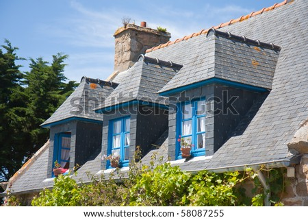 Traditional Breton house with typical dormers and shutters in France - stock photo