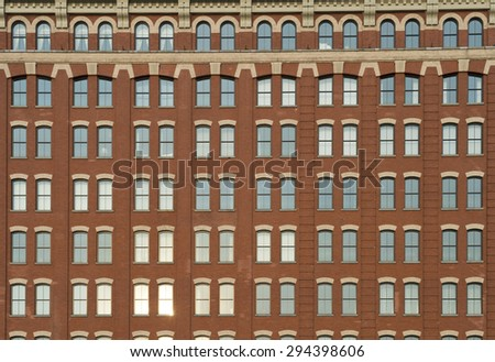 Traditional brick architecture skyscraper with arched window details full frame background - stock photo