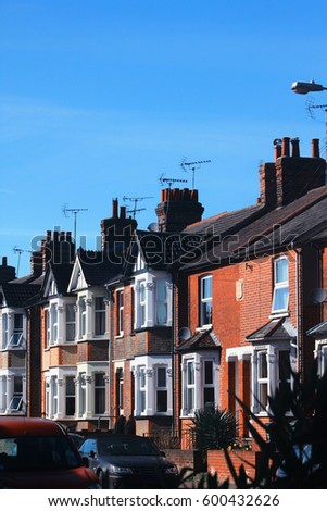 traditional British brick terrace houses with a lovely blue sky sunny day background, Spring time of England UK.