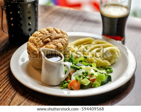 Traditional British pub food of a Chicken Pot Pie with mashed potatoes and gravy and mixed & Traditional British Pub Food Chicken Pot Stock Photo (Safe to Use ...