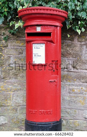 Traditional British Red Post Box on a London Street - stock photo