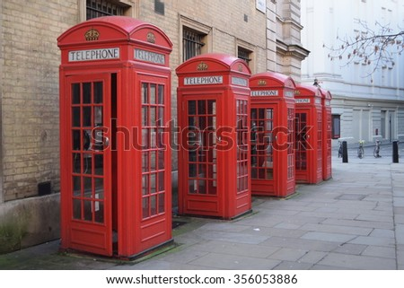 Traditional British red telephone boxes in a row
