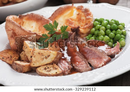 Traditional british sunday roast with yorkshire pudding and vegetables - stock photo