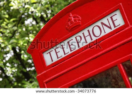 traditional british telephone in the middle of nature - stock photo