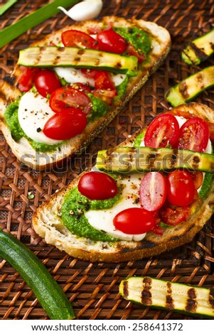 Traditional bruschetta with grilled baby zucchini - stock photo