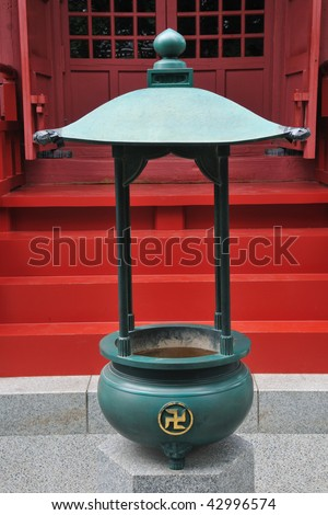 Traditional Buddhist ash-urn close to Japanese Temple - stock photo
