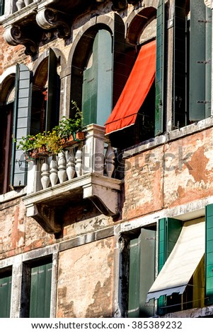 Traditional building exterior with typical windows on the Grand Canal in Venice, Italy - stock photo
