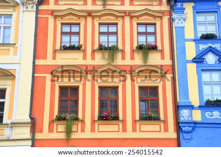 Traditional buildings with flowers decorating beautiful facades on the streets of Prague, Czech Republic - stock photo