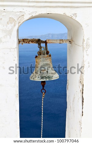 Traditional campanile at Fira city of Santorini island in Greece - stock photo