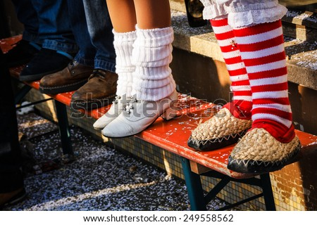 Traditional carnival in South Germany - Swabian-Alemannic Fastnacht. Feet of differens costumes. Selective focus - stock photo