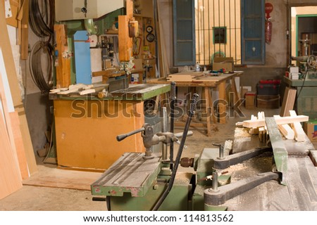 Traditional carpenter workshop  with its wealth of tools and wood - stock photo