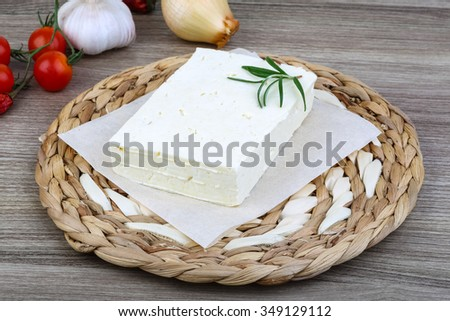 Traditional Caucasian homemade Cheese Brinza with rosemary on wood background
