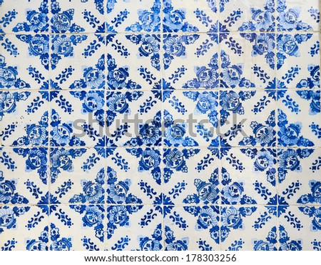 traditional ceramic tiles on the wall in the street in Portugal - stock photo