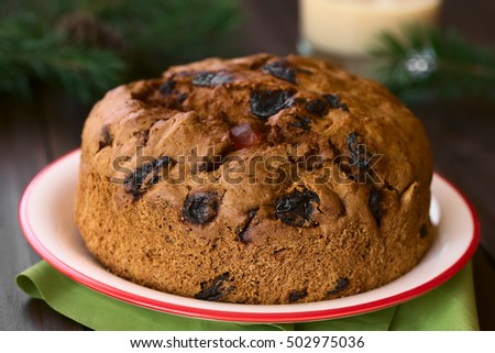 Traditional Chilean Pan de Pascua Christmas Cake made with spices, dried fruits and raisins, photographed with natural light (Selective Focus, Focus on the front of the cake)