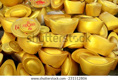 Traditional chinese ancient gold bullion nugget. - stock photo