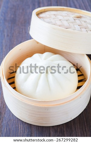 Traditional chinese cuisines steamed bun in asian style bamboo basket