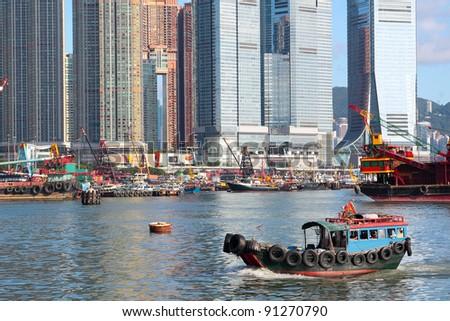 Traditional Chinese fishing junk in Victoria Harbor, Hong Kong - stock photo