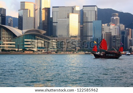 Traditional Chinese Junkboat sailing in Victoria Harbor, Hong Kong - stock photo