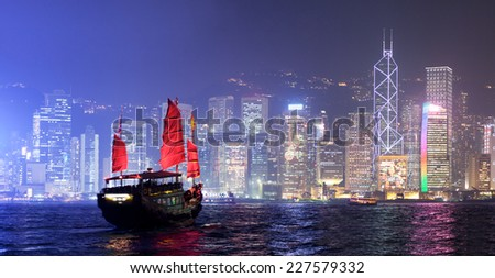 Traditional Chinese Junkboat sailing in Victoria Harbour, Hong Kong - stock photo