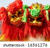 traditional chinese lion dancing in holiday. - stock