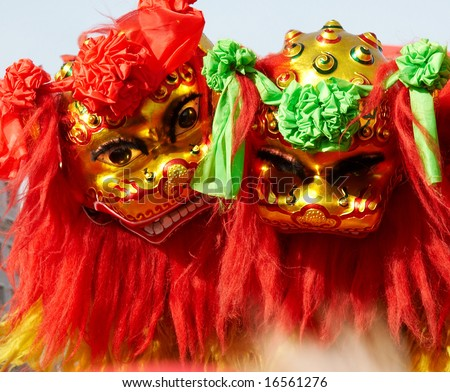 traditional chinese lion dancing in holiday. - stock photo
