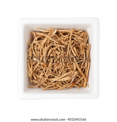 Traditional Chinese Medicine - Ginseng fibers in a square bowl isolated on white background