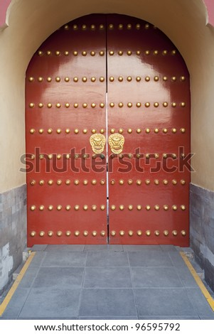 traditional Chinese red door at Temple of Heaven in Beijing which is one of the landmark of Beijing - stock photo