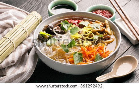 Traditional chinese soup with noodles, mushrooms and vegetables