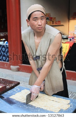 Traditional Chinese vendor - stock photo