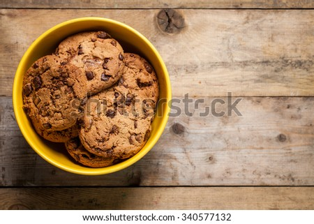 Traditional chocolate chip cookies on rustic wooden table. Space for text. View top. - stock photo