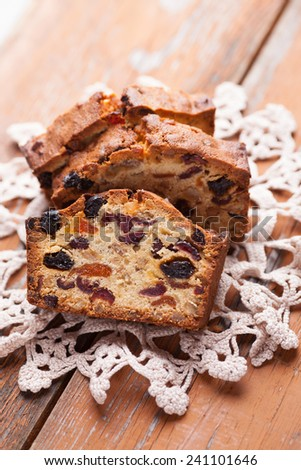 Traditional Christmas cake - Stollen on wooden table