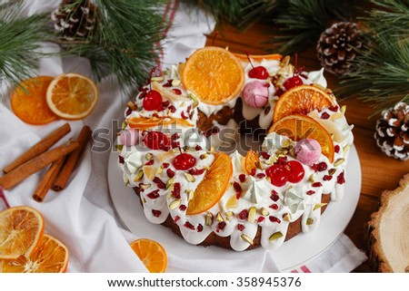 Traditional Christmas cake with holiday background. Decorated bundt cake. Shallow focus - stock photo