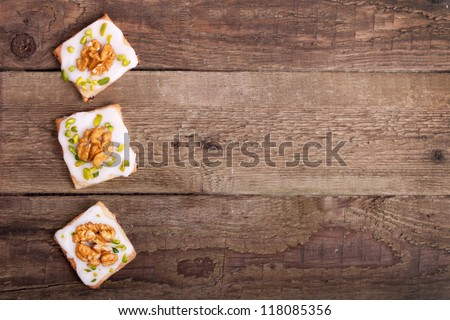 Traditional christmas cookies with walnut and pistachio nuts on a wooden board - stock photo