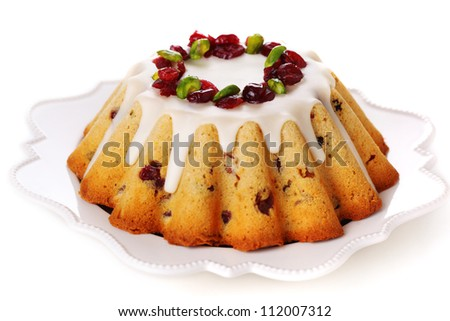 Traditional Christmas fruit cake isolated on white background. - stock photo