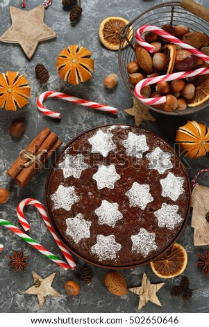 Traditional Christmas fruit cake on a gray background