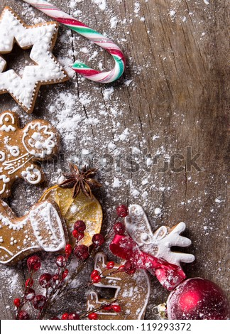 Traditional christmas Gingerbread cookies over wooden background - stock photo