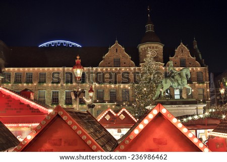 Traditional Christmas Market in Dusseldorf, Germany with the Jan-Wellem bronze statue, a giant Christmas tree and the historic town hall turning the city into a winter's fairy tale. - stock photo