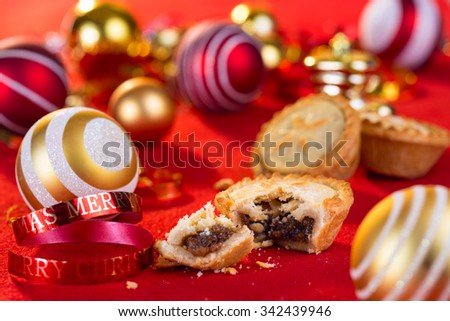 Traditional Christmas mince pies and xmas festive decorations