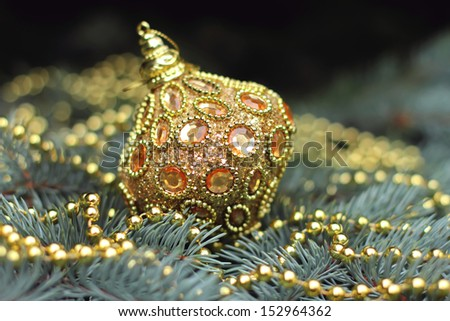 Traditional christmas or new year decorated tree with a golden toy - stock photo