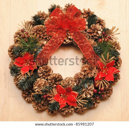 Traditional christmas wreath over wooden background - stock photo