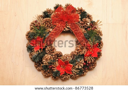 Traditional christmas wreath over wooden background