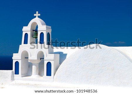 Traditional church at Oia village of Santorini island in Greece - stock photo