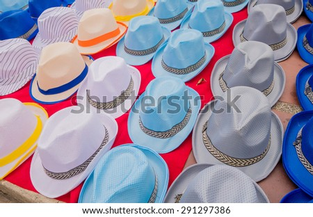 Traditional Colombian colorful straw hats from street vendors in Colombia's most important folklore celebration, the Carnival of Barranquilla, Colombia - stock photo