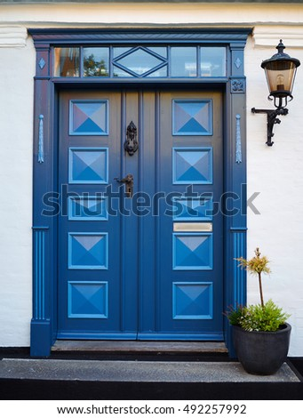 Traditional colorful craft vintage wooden blue front door Denmark