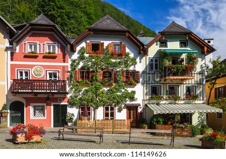 Traditional Colorful Houses Decorated With Flowers In Alpine Village Hallstatt Austria