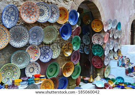 Traditional colorful Moroccan faience pottery dishes in a shop in the medina of Essaouira, Morocco