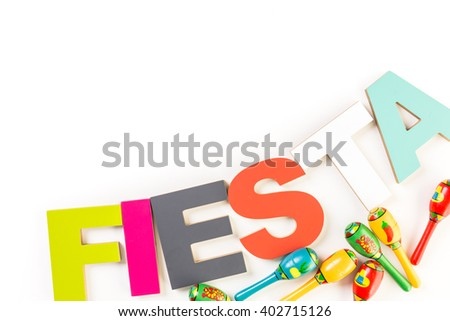 Traditional colorful table decorations for celebrating Fiesta. - stock photo
