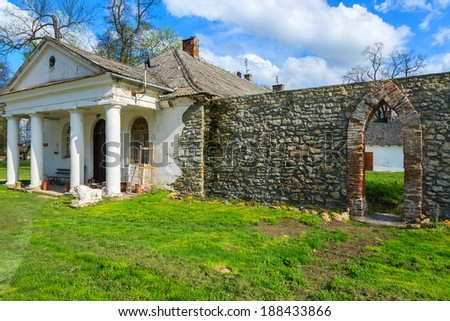 Traditional cottage house in rural area of Poland on sunny spring day - stock photo