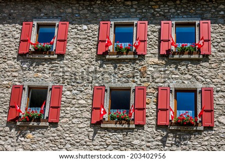 Traditional country house in switzerlands alps - stock photo