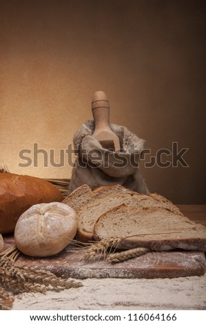 Traditional country theme with bread and cereals - stock photo